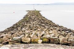 Quebra-mar de pedra Fotografia de Stock