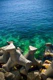 Quebra-mares do mar Fotos de Stock