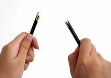 Quebrando um lápis Imagens de Stock