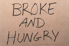 Quebrou e sinal com fome do cartão fotografia de stock