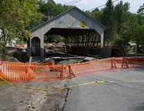 Quechee Covered Bridge after Irene. Tropical storm Irene dumped tons of water on Vermont causing massive flooding. This historic bridge in Quechee lost sections royalty free stock images
