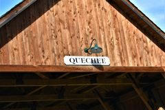 Quechee Covered Bridge, Quechee Village, Town of Hartford, Windsor County, Vermont, United States. View of the top of the wooden covered bridge showing signage stock image
