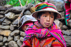Quechua boy with sister in a village in the Andes, Ollantaytambo Stock Photo
