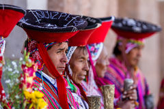 Quechua Elders in the Sacred Valley. Pisac, Peru - May 15: Quechua elders in traditional clothing in a small ceremony in the Pisac Market. May 15 2016, Pisac Royalty Free Stock Photography