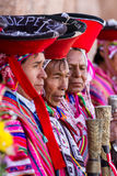 Quechua Elders in the Sacred Valley. Pisac, Peru - May 15: Quechua elders in traditional clothing in a small ceremony in the Pisac Market. May 15 2016, Pisac Stock Photography