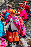 Quechua girl and family in a village in the Andes, Ollantaytambo Stock Photos