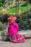Quechua girl with hat in a village in the Andes, Ollantaytambo, Stock Image