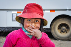 Quechua girl laughing in a village in the Andes, Ollantaytambo, Royalty Free Stock Photos