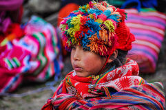 Quechua girl looking in a village in the Andes, Ollantaytambo, P Stock Images