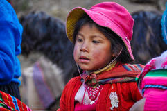 Quechua girl in a village in the Andes, Ollantaytambo, Peru Royalty Free Stock Photo