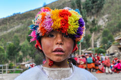 Quechua girl watching in a village in the Andes, Ollantaytambo, Royalty Free Stock Images