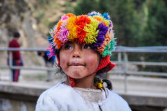 Quechua girl watching in a village in the Andes, Ollantaytambo, Royalty Free Stock Photo