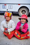 Quechua girls playing in a village in the Andes, Ollantaytambo, Stock Images