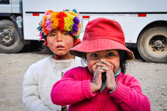 Quechua girls playing in a village in the Andes, Ollantaytambo, Royalty Free Stock Images