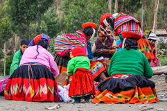 Quechua group talking in a village in the Andes, Ollantaytambo, Royalty Free Stock Photography