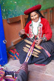 Quechua Indian woman weaving Royalty Free Stock Images