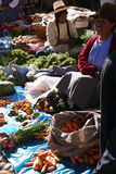 Quechua Indian women bargain and sell vegetables > Stock Photos