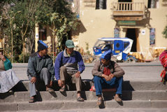 Quechua Indians  waiting for a bus, Stock Images