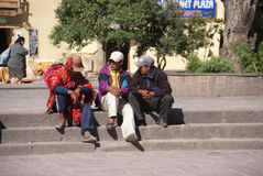 Quechua Indians  waiting for a bus, Royalty Free Stock Photo