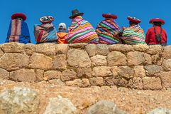 Quechua Indigenous on Inca Wall, Peru royalty free stock photography