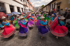 Quechua indigenous women dancing in the street Stock Photos