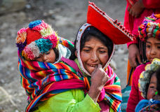 Quechua mother and baby in a village in the Andes, Ollantaytambo Royalty Free Stock Photos