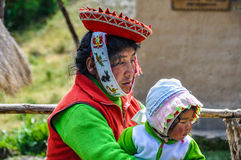 Quechua mother and baby in a village in the Andes, Ollantaytambo Royalty Free Stock Images