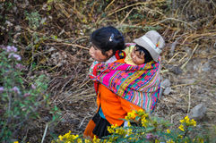 Quechua mother with child in a village in the Andes, Ollantaytam Stock Photo