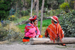 Quechua mother and son in a village in the Andes, Ollantaytambo, Stock Images