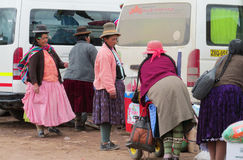 Quechua woman at the bus stop in latin american. Latin american women in small village in South America. Peru, Bolivia, Argentina Royalty Free Stock Photo