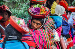 Quechua woman in colorful hat in a village in the Andes, Ollanta Stock Photo