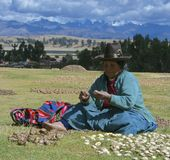 Quechua woman with dried potatoes. Royalty Free Stock Photography