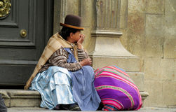 Quechua woman in traditional cloth and hat. Quechua woman in traditional cloth and black hat sitting on the stairs of the church, latin american women in South stock photography