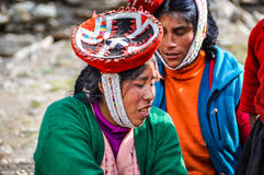 Quechua woman in a village in the Andes, Ollantaytambo, Peru Royalty Free Stock Photo