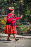 Quechua woman walking in a village in the Andes, Ollantaytambo, Royalty Free Stock Images