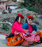 Quechua women in colorful dress in a village in the Andes, Ollan Royalty Free Stock Image