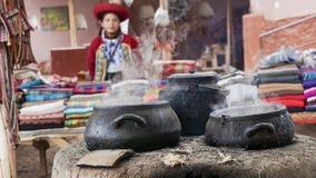 A Quechuan woman demsontrates alpaca wool weaving. royalty free stock photography
