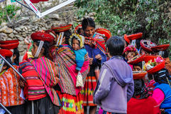 Quechuas waiting in a village in the Andes, Ollantaytambo, Peru Royalty Free Stock Image
