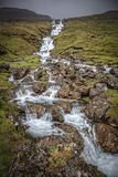Queda da água em Faroe Island Imagens de Stock Royalty Free