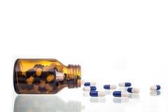 Queda da garrafa de comprimido Fotografia de Stock Royalty Free
