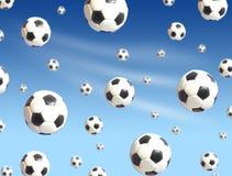 Queda das esferas de futebol Fotografia de Stock