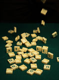 Queda das letras do Scrabble Imagem de Stock