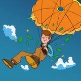Queda de sorriso do homem em um paraquedas dourado Imagens de Stock