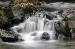 Queda muito lenta da água do obturador Imagem de Stock