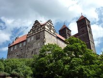 Quedlinburg Castle-hill. Situated on a sandstone cliff, the more than a thousand year old Romanesque collegiate church St. Servatius towers as an imposing stock photography