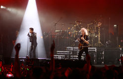 Queen with Adam Lambert perform onstage during charity concert i Royalty Free Stock Image