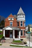 Queen Anne in Dubuque. This is a Spring picture of the Michael S. Hardie House located in Dubuque, Iowa.  This house built in 1906 is an example of Queen Anne Royalty Free Stock Image