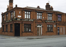 "The Queen Anne. Manchester, England – 18th August 2015. ""The Queen Anne"", a well known local pub in North Manchester, which is now run down due to the Stock Images"