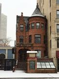 Queen Anne in Snow Storm. This is a picture of a 19th Century Queen Anne building during a snow storm in the Lincoln Park neighborhood in Chicago, Illinois Stock Photography