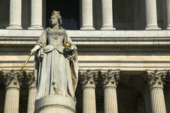 Queen Anne Statue St.Pauls Cathedral. Queen Anne was the reigning monarch when St.Pauls Cathedral was finished in 1710 and her statue stands at the west front of royalty free stock photo